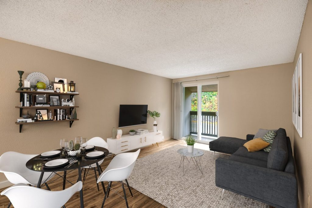 Spacious living room with hardwood-style floors at Karbon Apartments in Newcastle, Washington