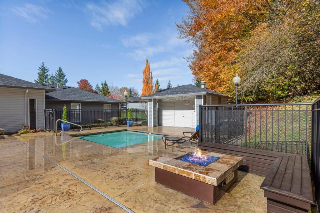 Fire pit and spa at Pebble Cove Apartments in Renton, Washington