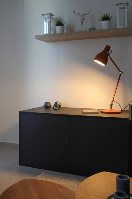 black wooden desk and brown desk lamp
